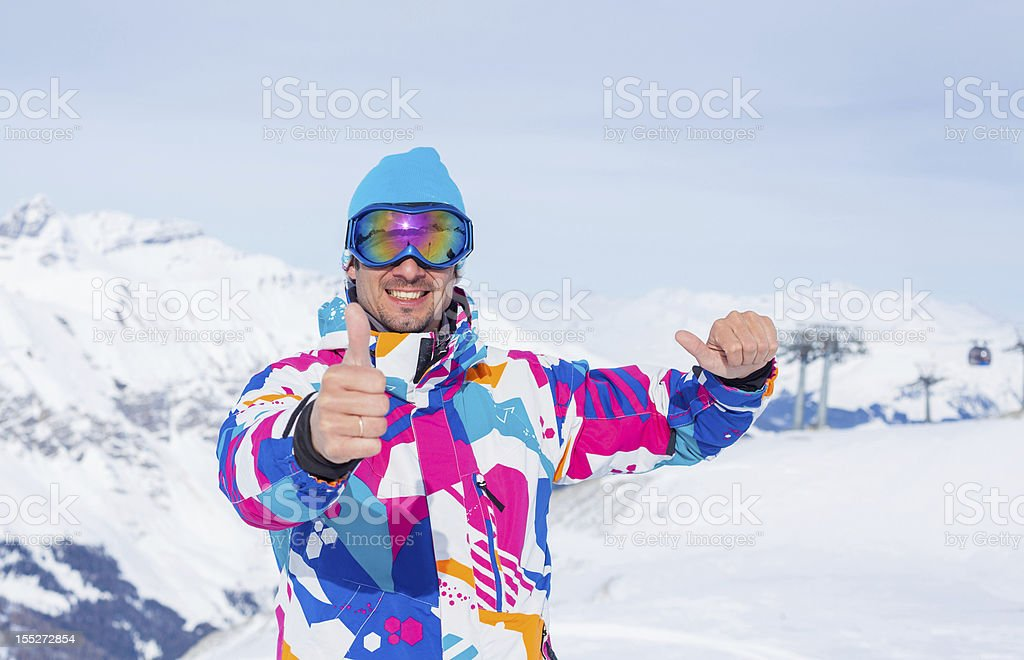 Young man with skis and a ski wear royalty-free stock photo