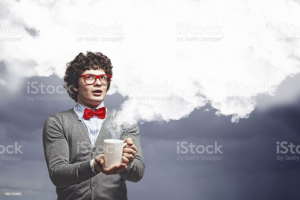 Young man with smoke coming out of cup stock photo