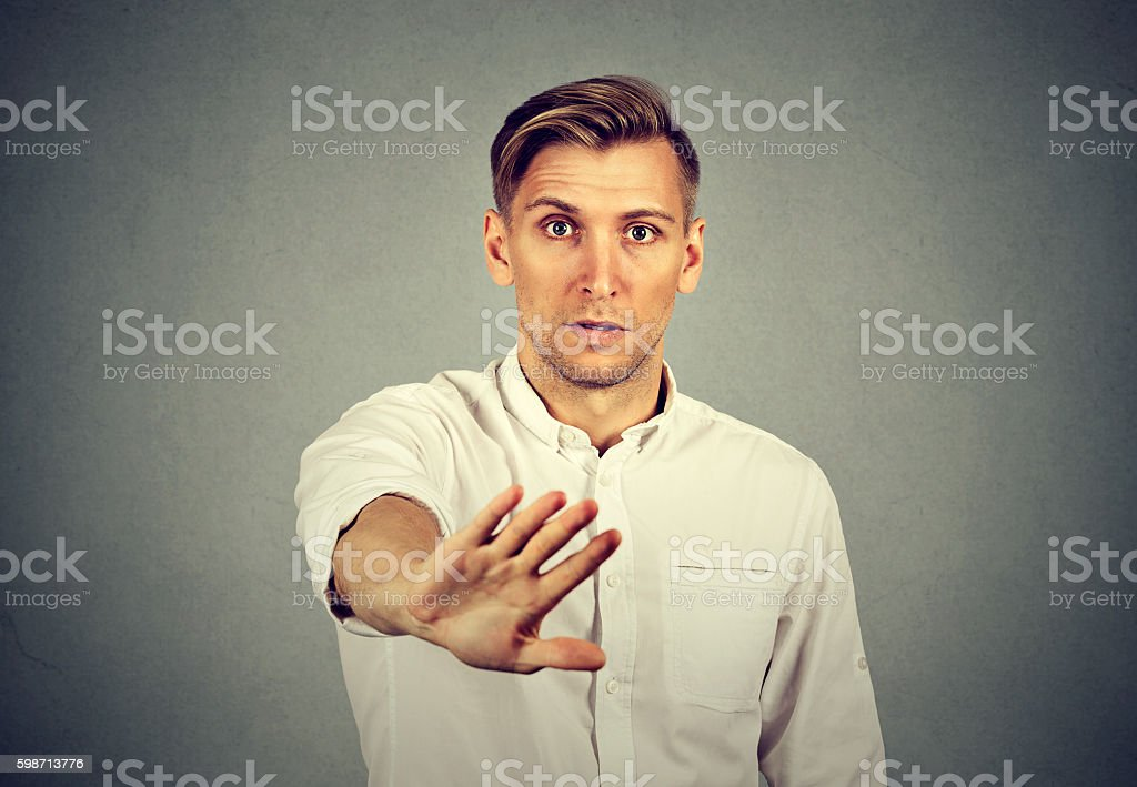 young man with stop hand gesture stock photo