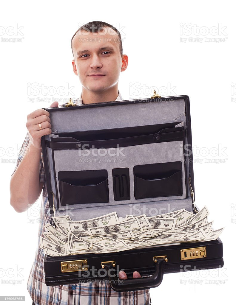young man with suitcase full of money royalty-free stock photo