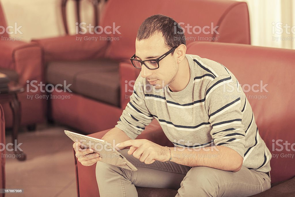 Young Man with Tablet PC at Hotel royalty-free stock photo
