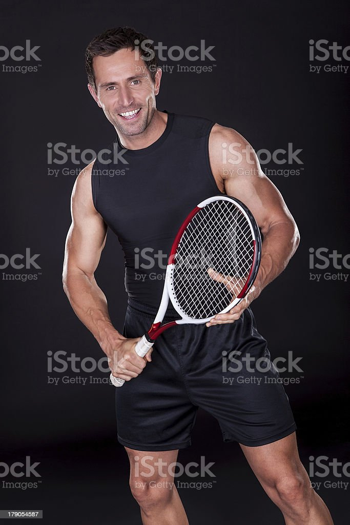Young Man With Tennis Racket stock photo
