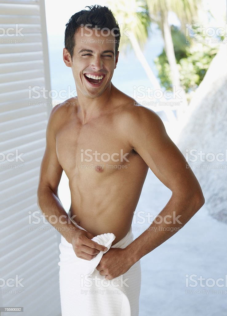 Young man with towel around waist royalty-free stock photo