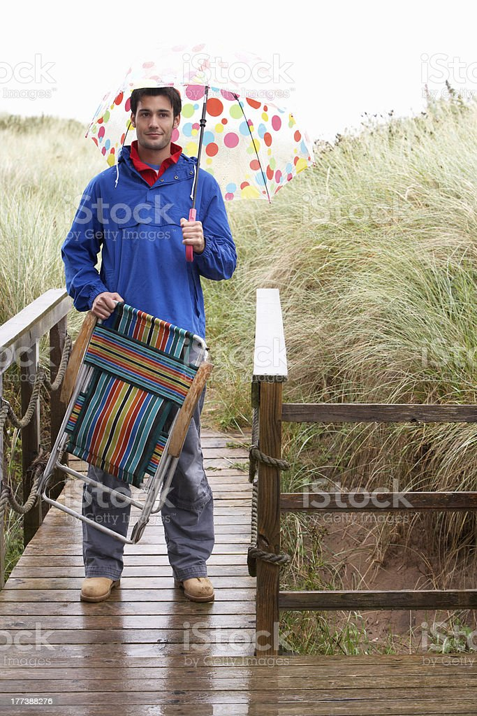 Young man with umbrella royalty-free stock photo