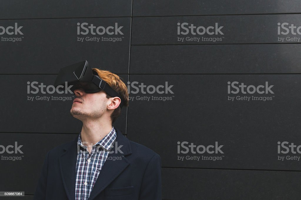 Young man with virtual reality headset stock photo