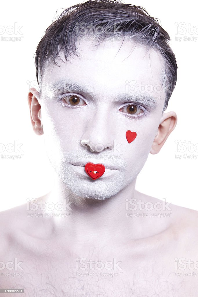 young man with white makeup and red hearts on face royalty-free stock photo