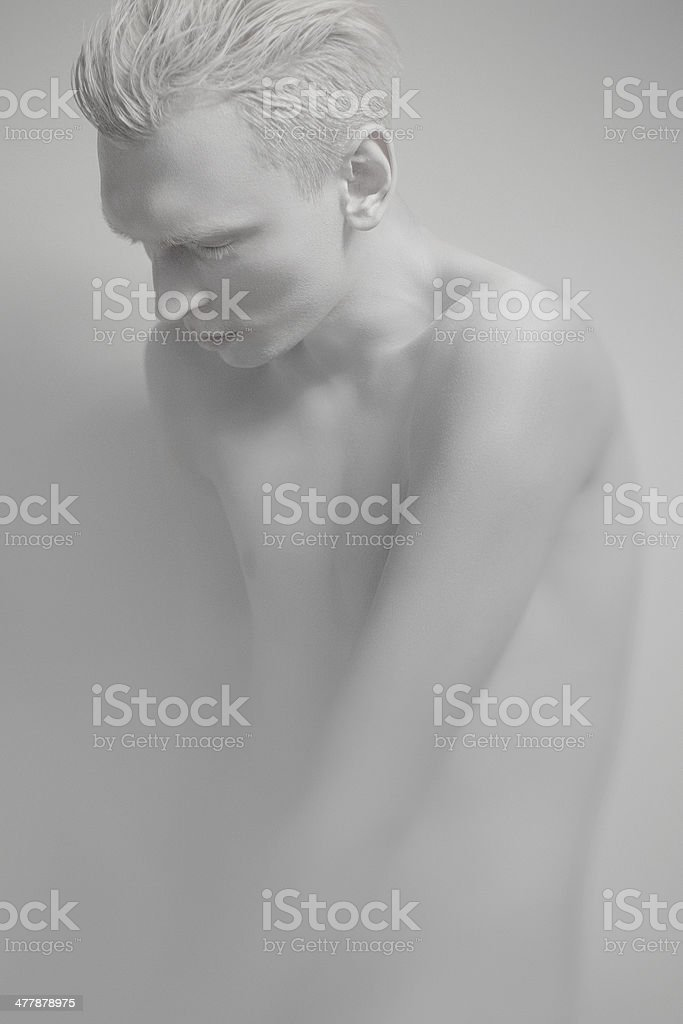 Young man with white skin looking down royalty-free stock photo