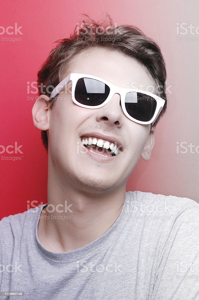 young man with white sunglasses royalty-free stock photo