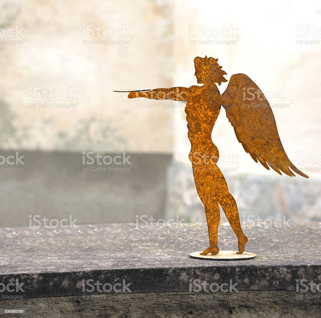 Young man with wings made of metal royalty-free stock photo