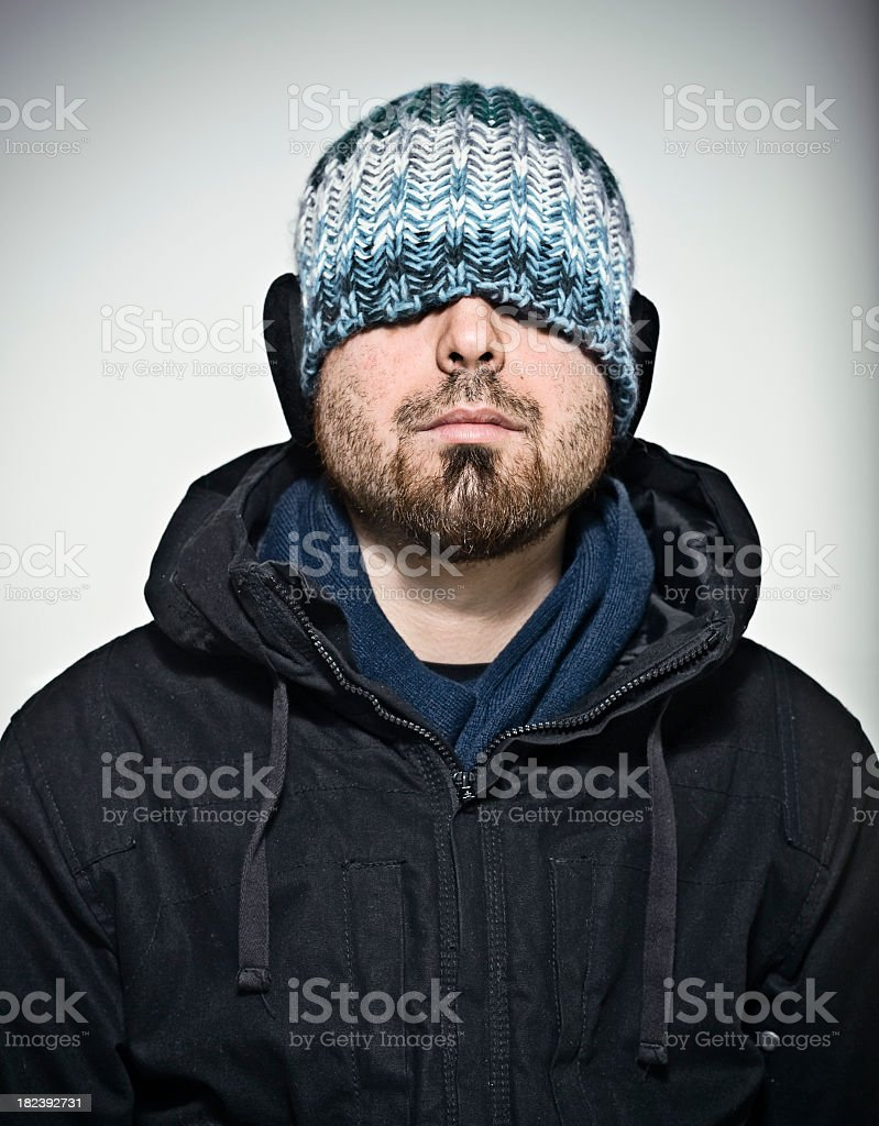 young man with winter hat and earflaps royalty-free stock photo
