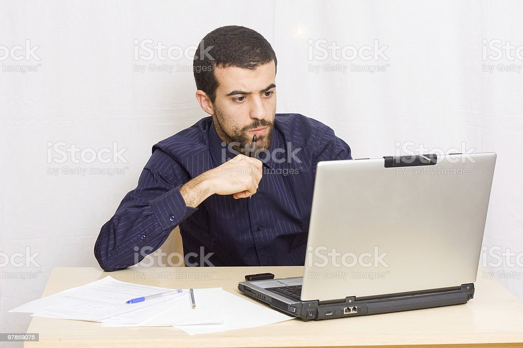 Young Man Working at His Desk royalty-free stock photo