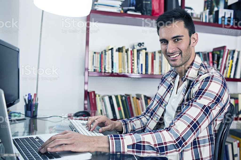 Young man working at home on his new business royalty-free stock photo