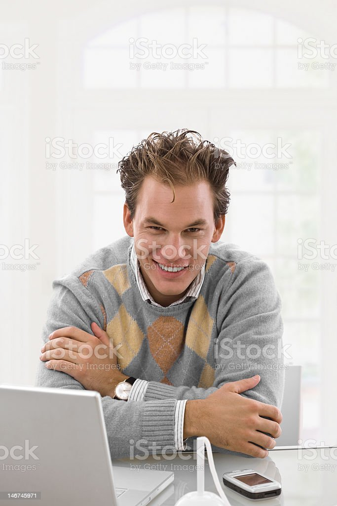 Young man working at home royalty-free stock photo