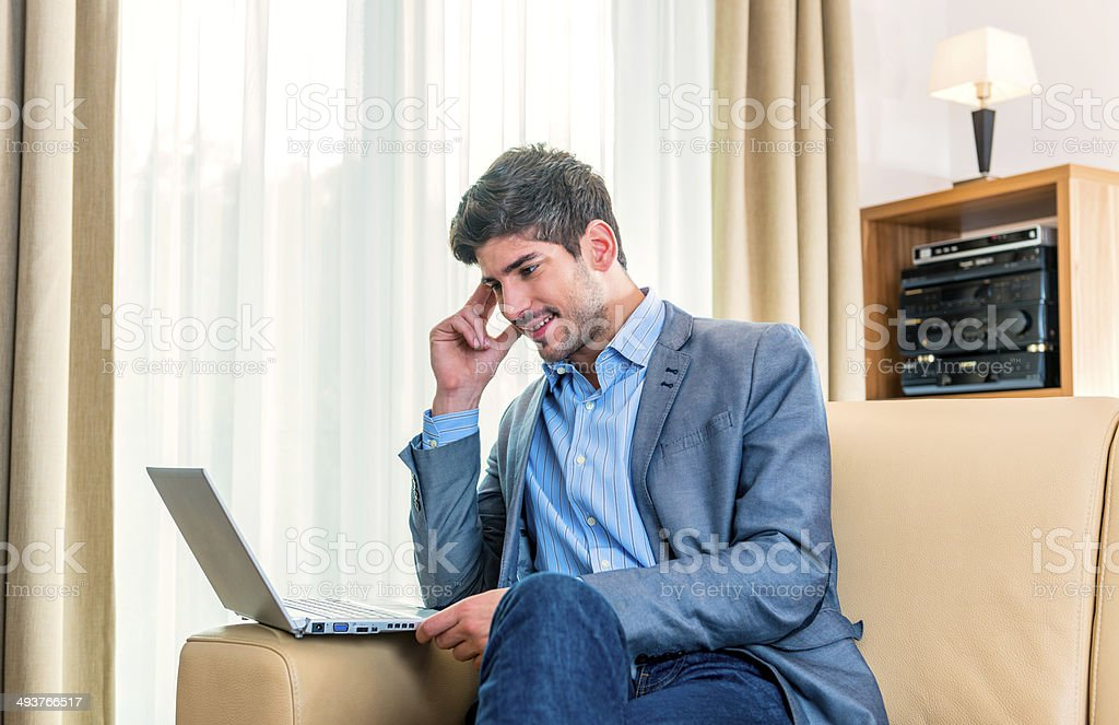 Young man working at laptop royalty-free stock photo