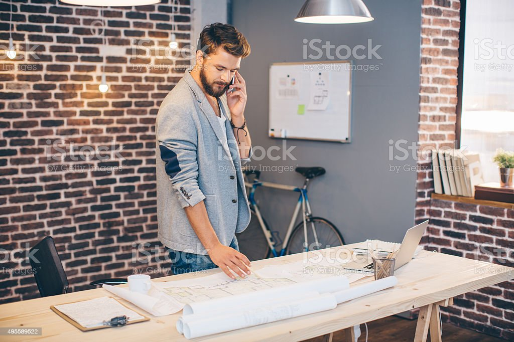 Young man working at modern office space. stock photo