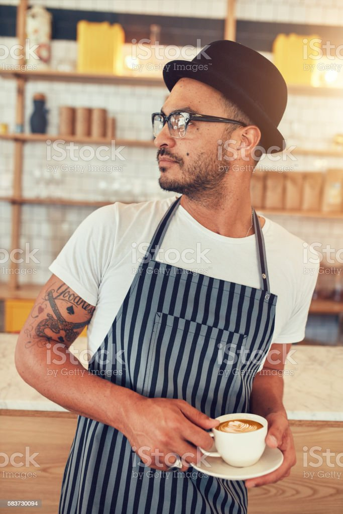 Young man working in coffee shop stock photo