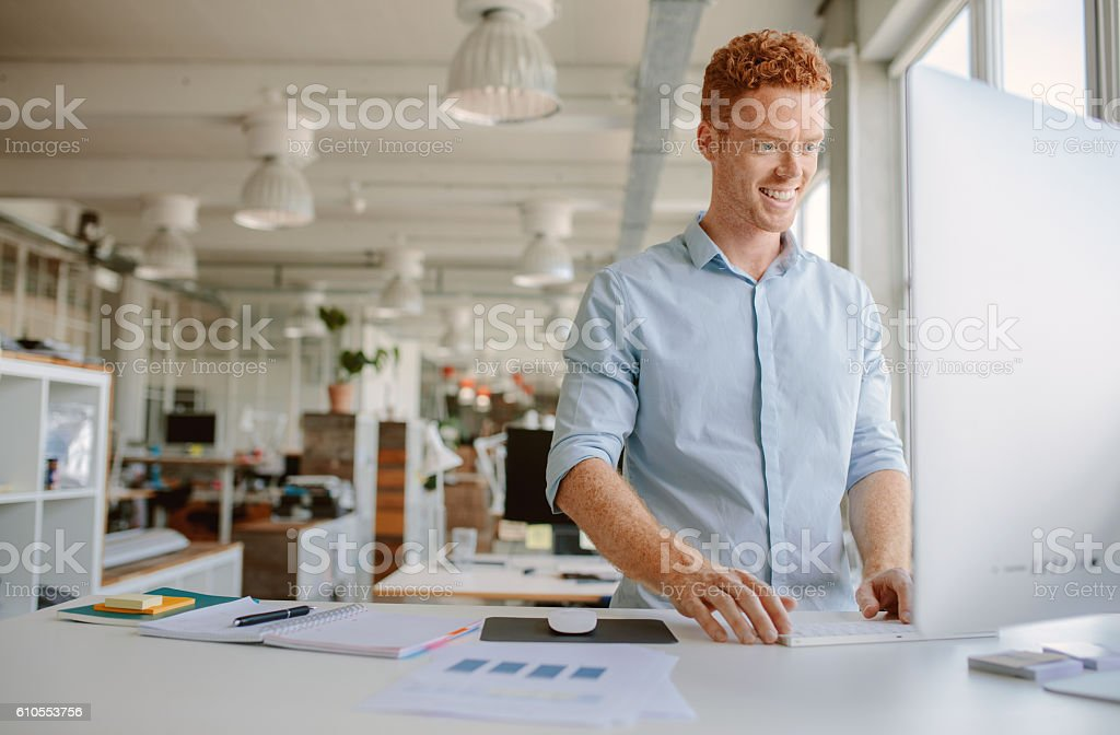 Young man working in modern office stock photo