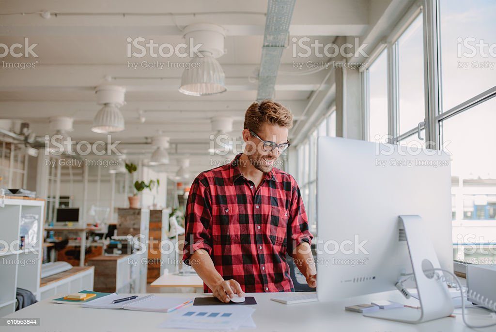Young man working in modern workplace stock photo
