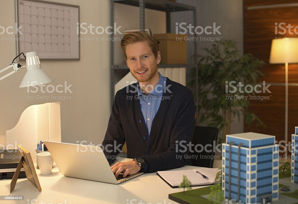 Young man working late. royalty-free stock photo