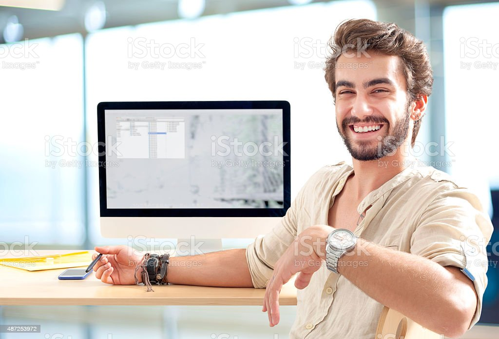 Young man working on computer stock photo