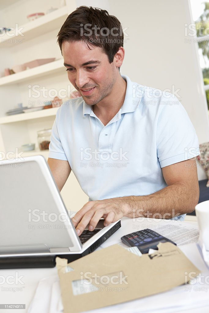 A young man working on his laptop royalty-free stock photo