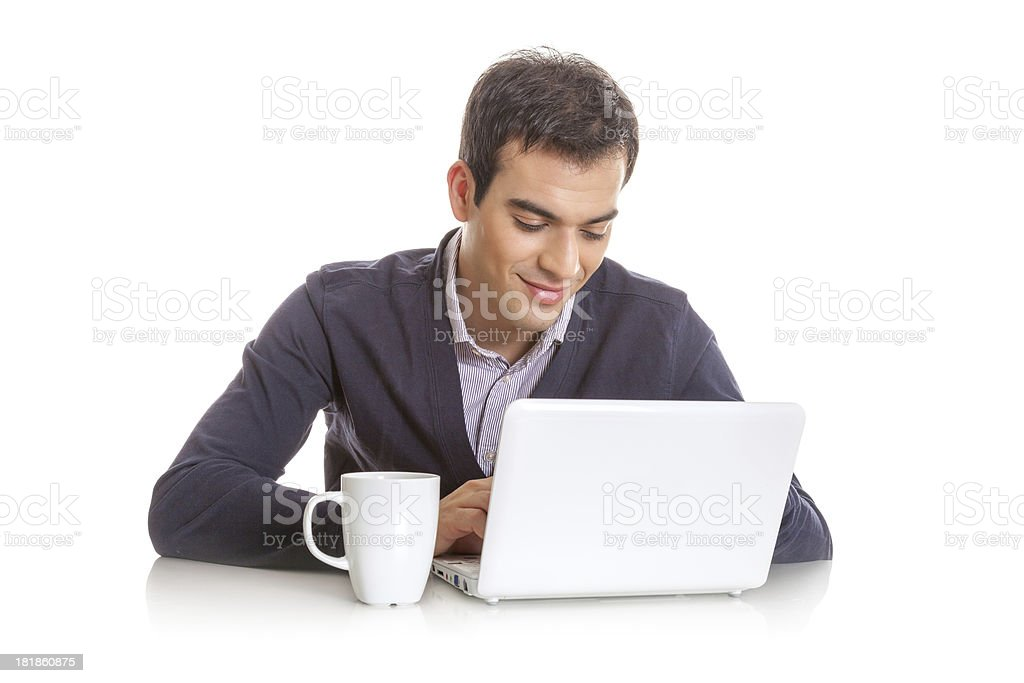 Young man working on laptop computer royalty-free stock photo