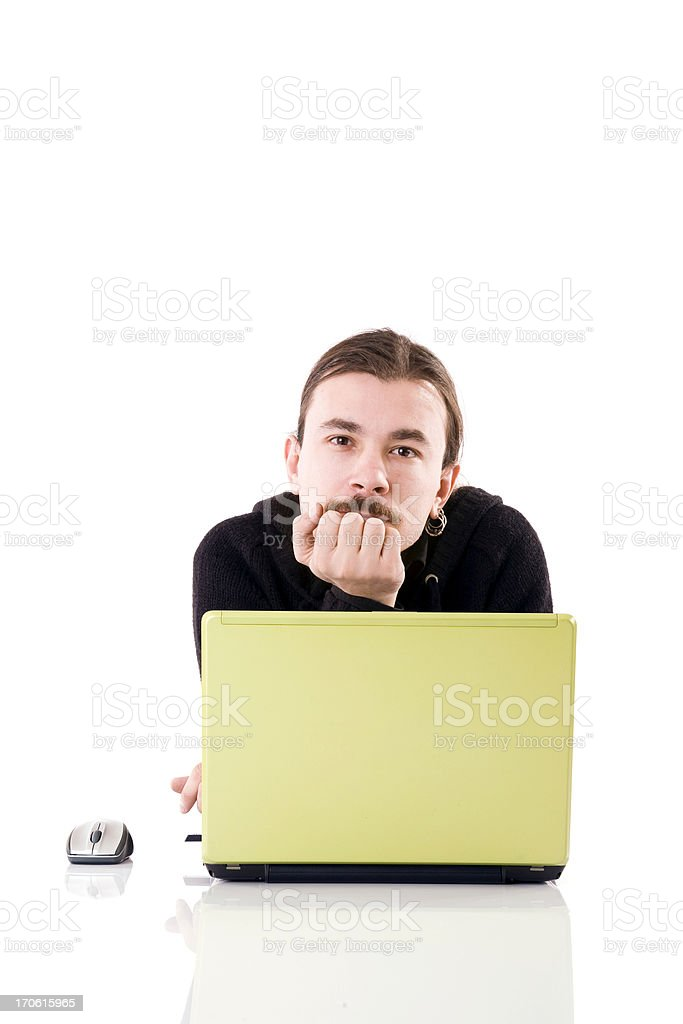 Young man working on laptop royalty-free stock photo