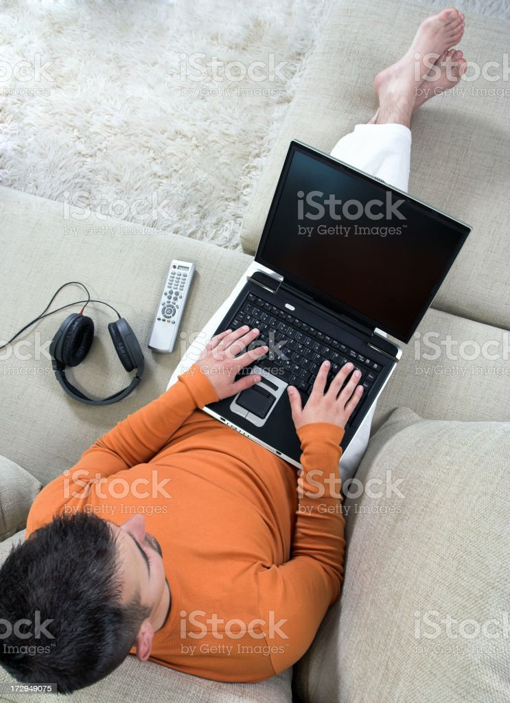 Young man working or studying at home royalty-free stock photo