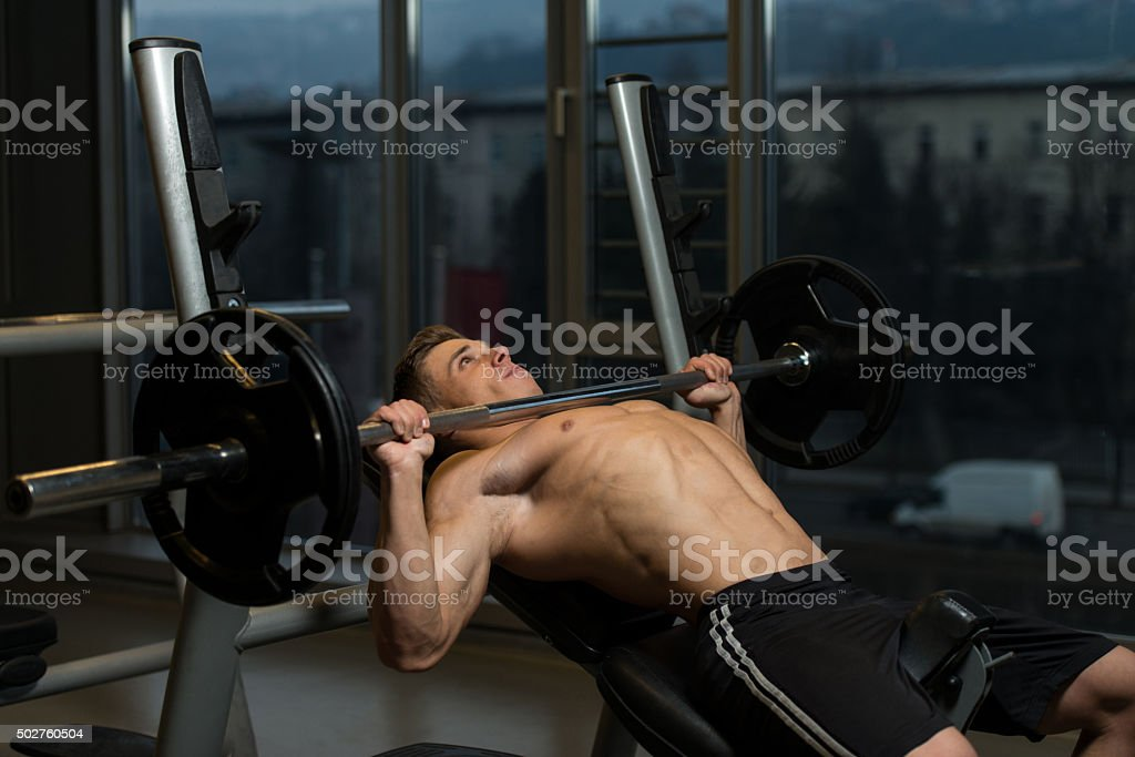 Young Man Working Out Chest stock photo