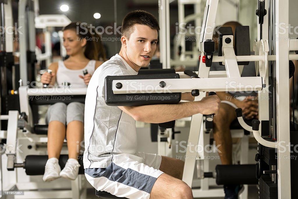 Young man working out in a gym. royalty-free stock photo
