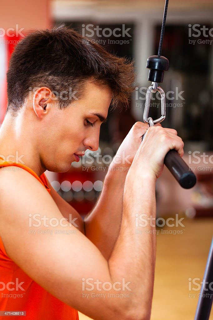 Young man working out in gym stock photo