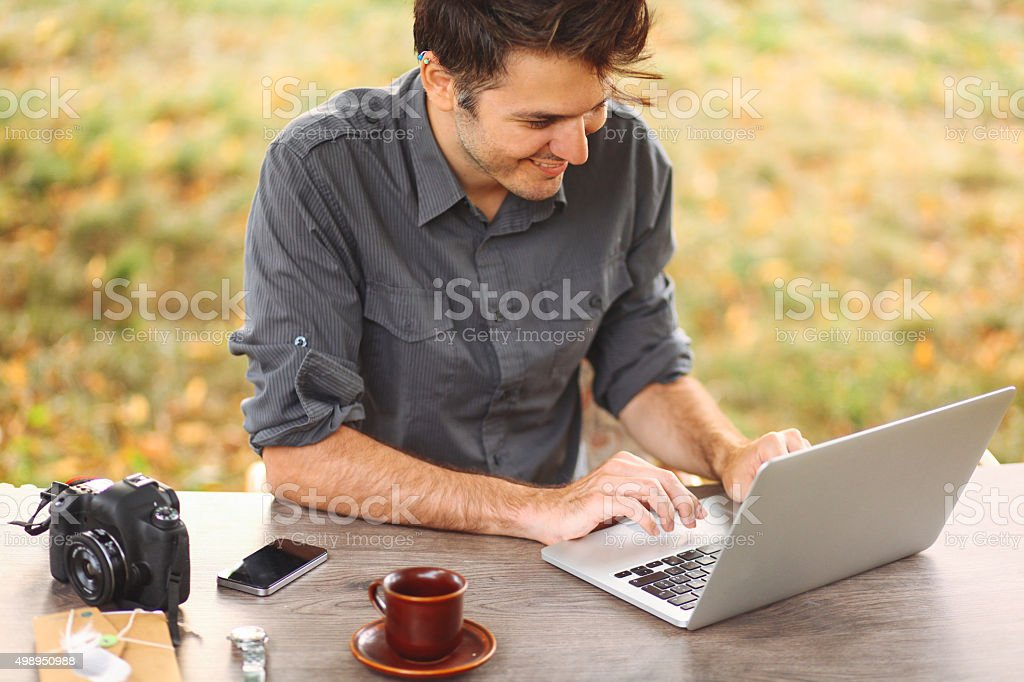 Young man working outdoors stock photo