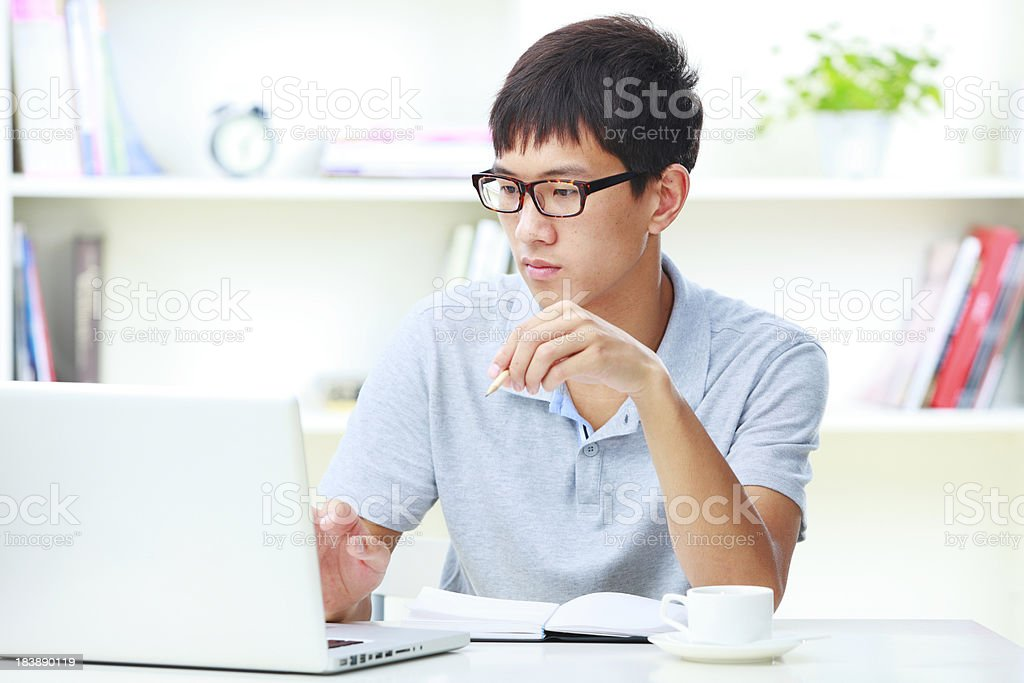 young man working with laptop in home office royalty-free stock photo