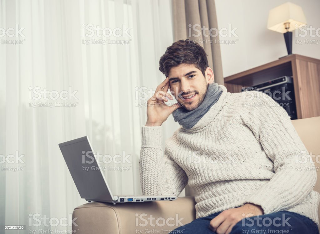 Young man working with laptop stock photo