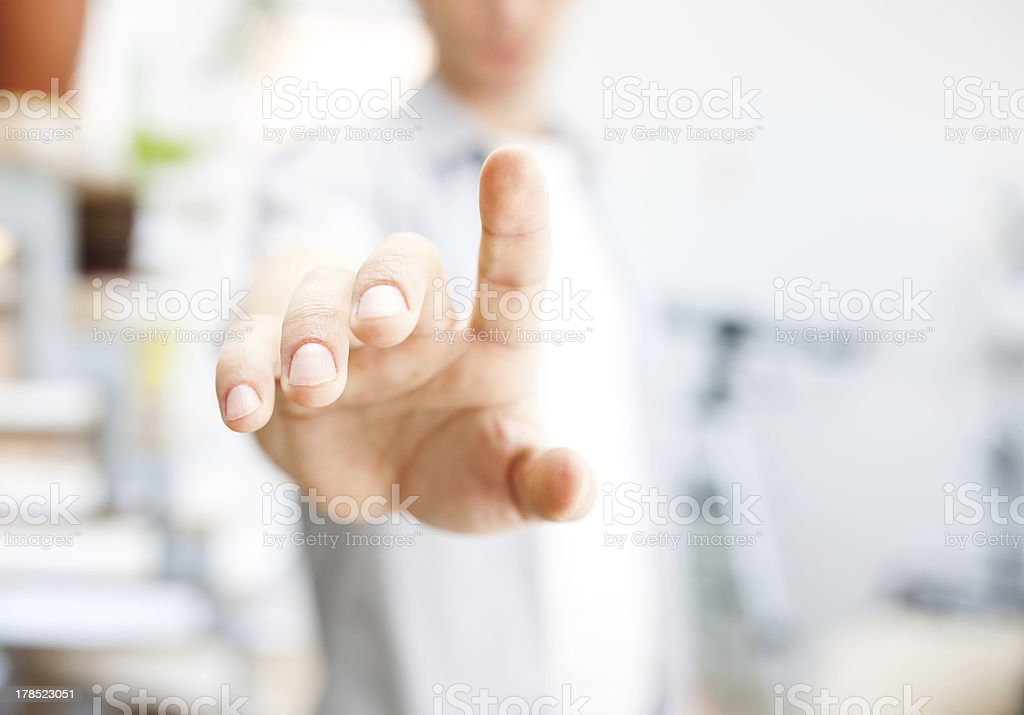 Young man working with virtual screen or pushing button stock photo
