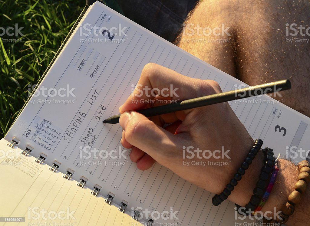 Young Man Writing On The Grass stock photo