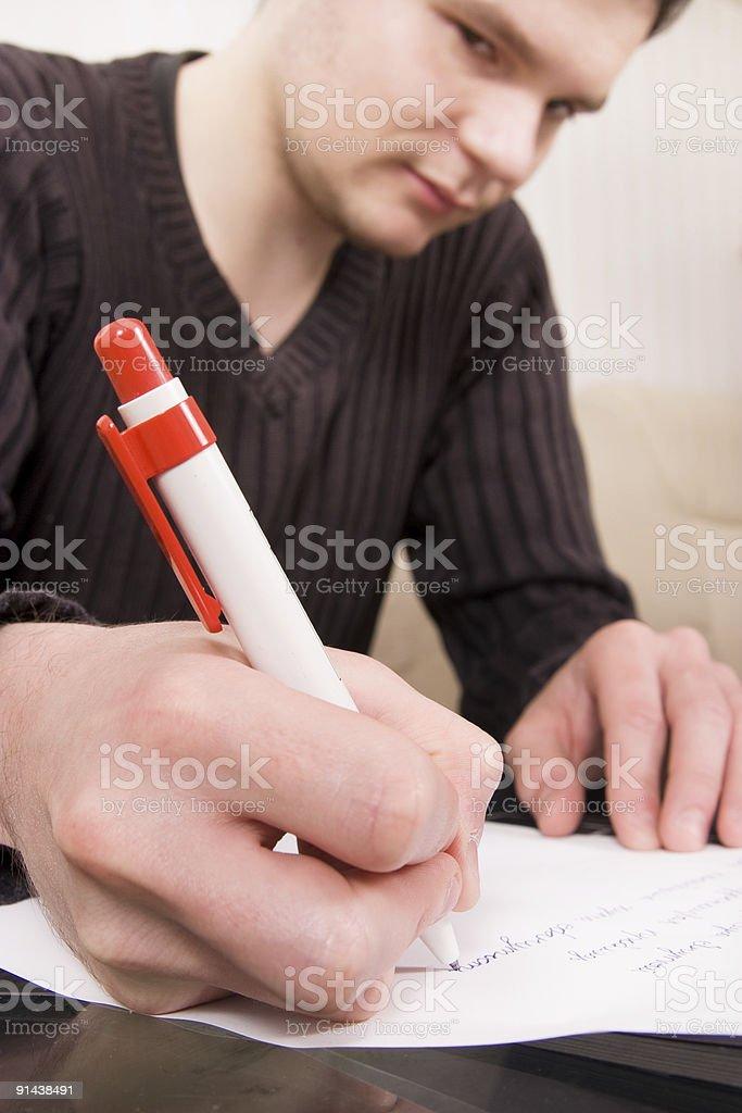 Young man writing royalty-free stock photo