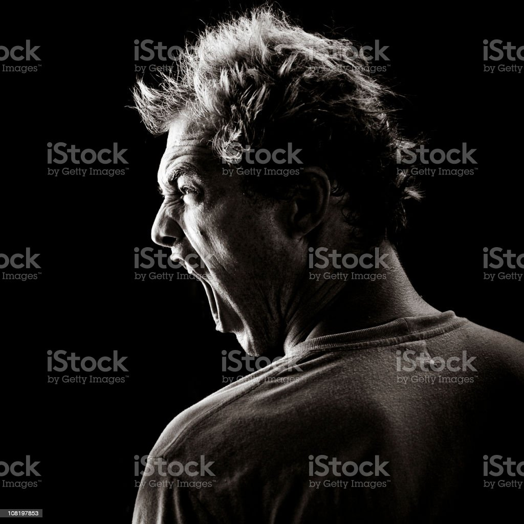 Young Man Yelling on Black Background royalty-free stock photo