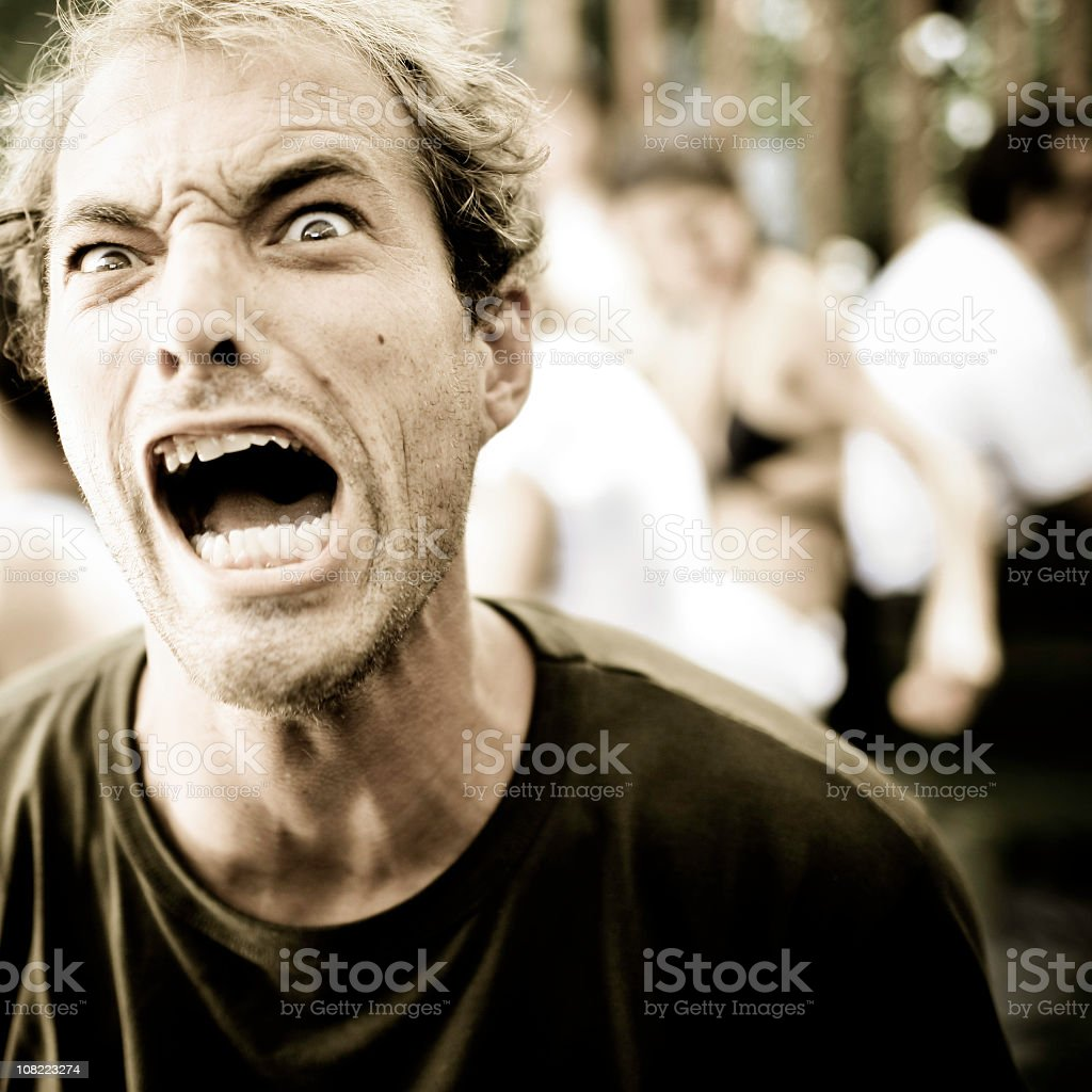Young Man Yelling, Sepia Toned royalty-free stock photo