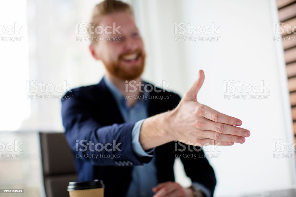 Young manager made a deal stock photo