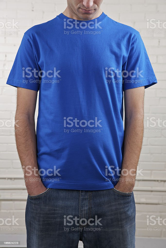 Young man's chest with blank blue shirt stock photo