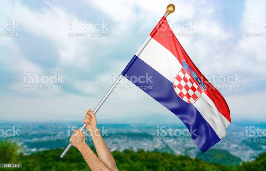 Young man's hands proudly waving the Croatia national flag stock photo