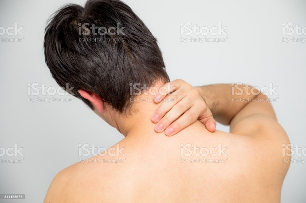 young man\'s neck and shoulders back view