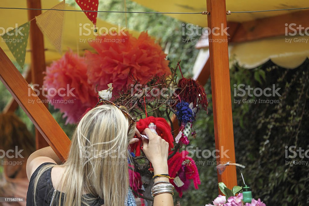 young market trader displays merchandise royalty-free stock photo