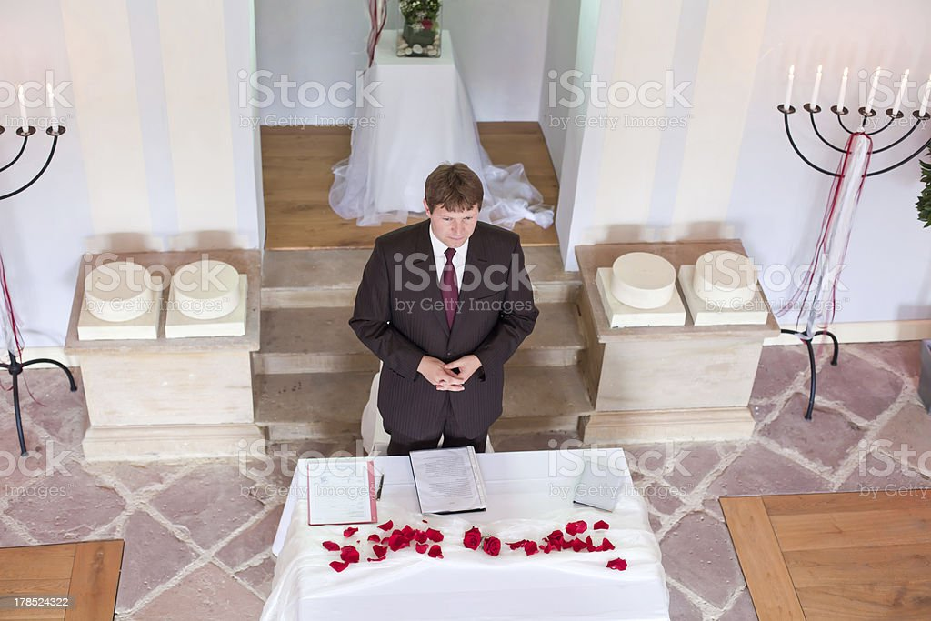 Young marriage celebrant performing wedding ceremony stock photo