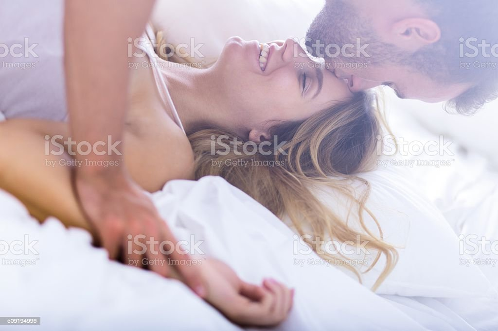 Young marriage during morning sex stock photo