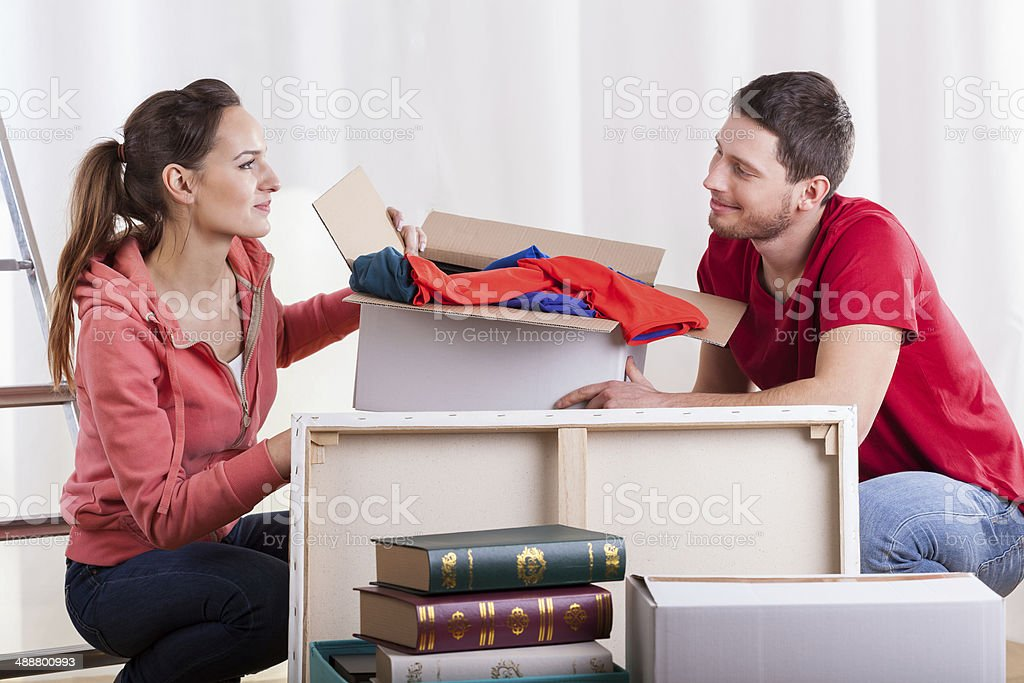 Young marriage packing stuff stock photo