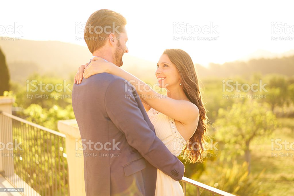 young married couple hugging at bright sunshine stock photo