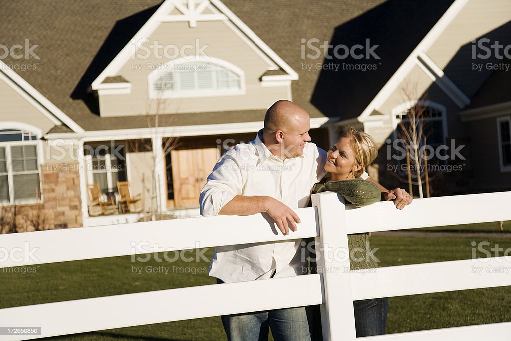 Young Married Couple in Front Yard royalty-free stock photo