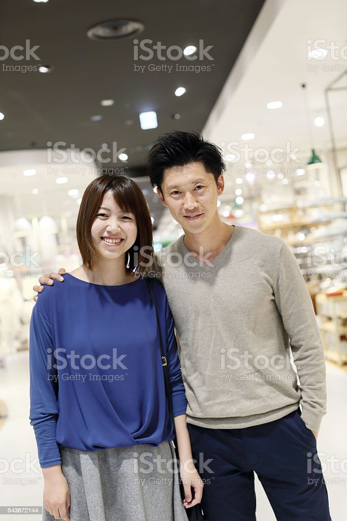 Young married couple shopping in a department store stock photo